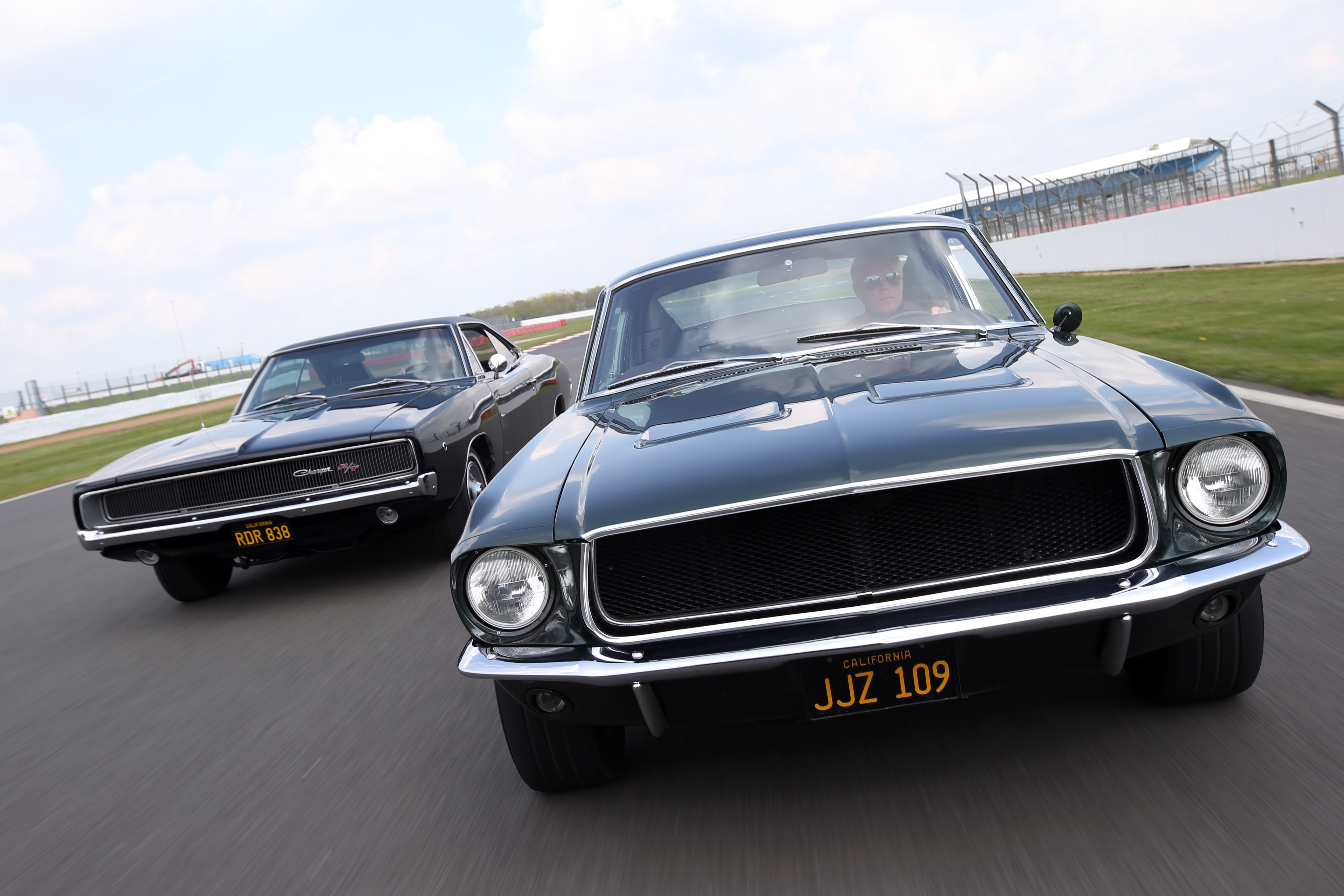 : The Dodge Charger and Ford Mustang power down the Silverstone straights