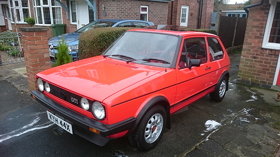 Red Mk1 Golf GTI parked on drive