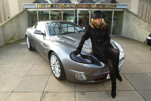 Britt Ekland with an Aston Martin