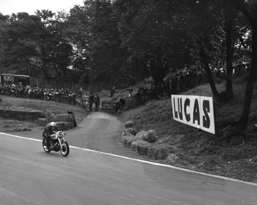 Norton bike being ridden to race glory in the 1950s