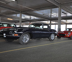 Three E-type Jaguars are ready for embarkation, ahead of the Jaguar Enthusiasts' Tour.