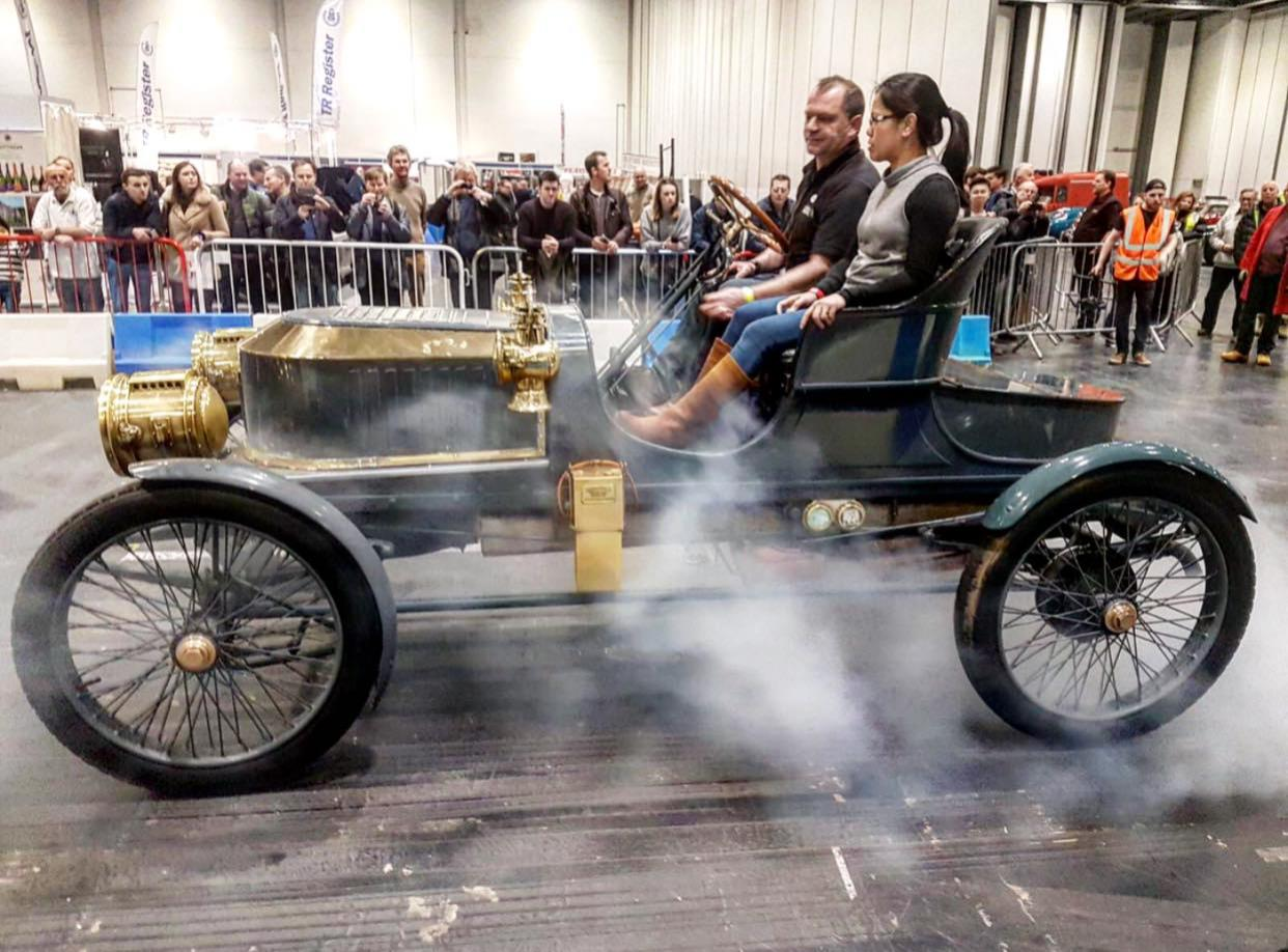 A vintage motor being driven to the show