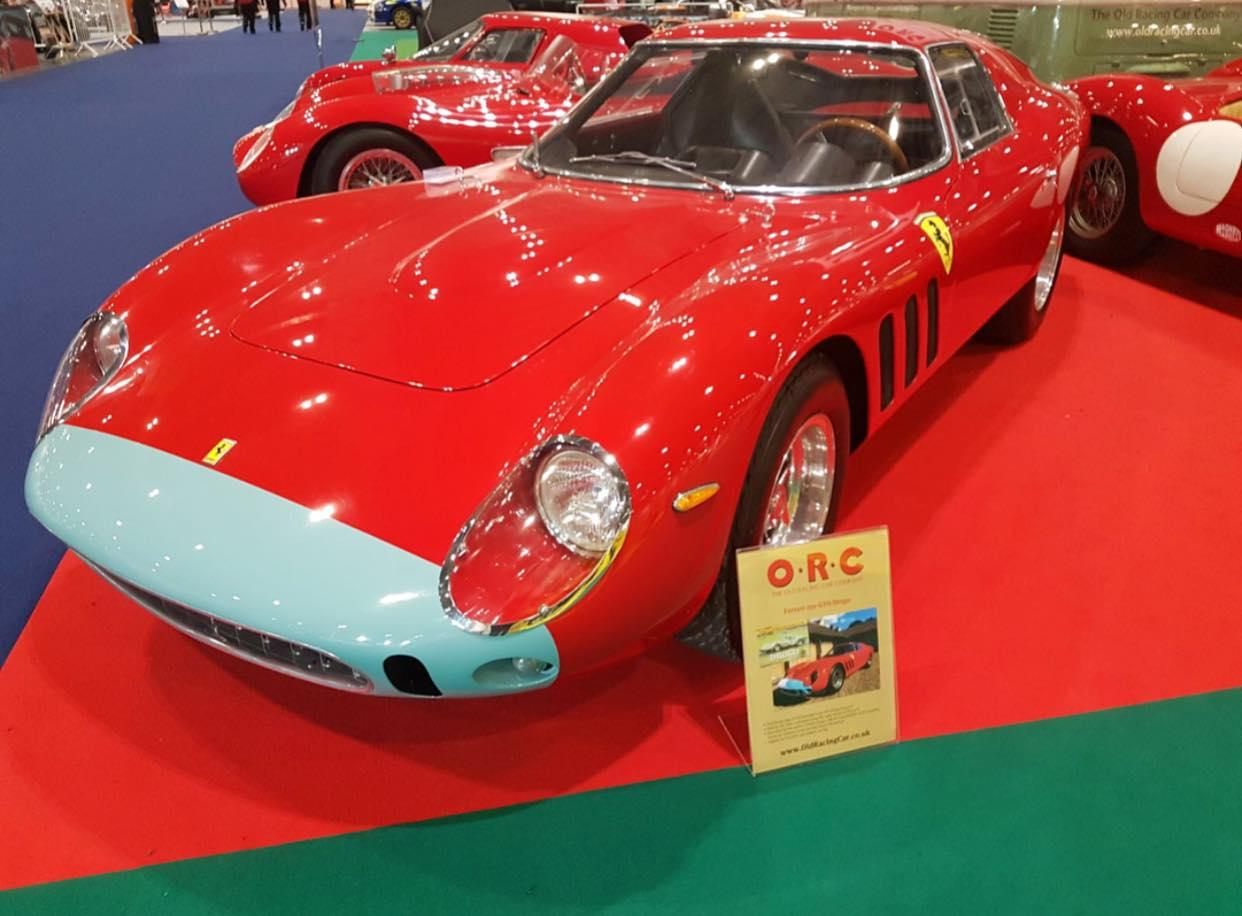 An Old Racing Car Company red Ferrari with baby blue nose