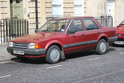 red Ford Orion parked on a road