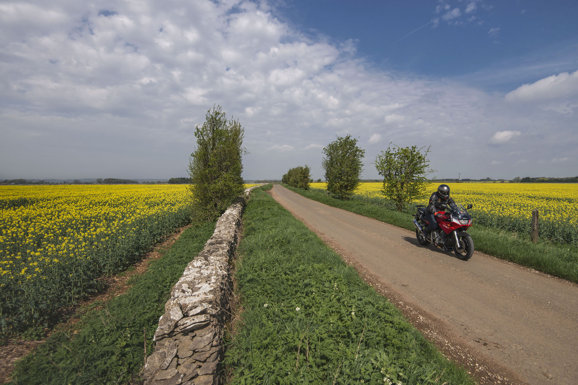 Bike whizzes down country lanes toward the Classic Motor Hub