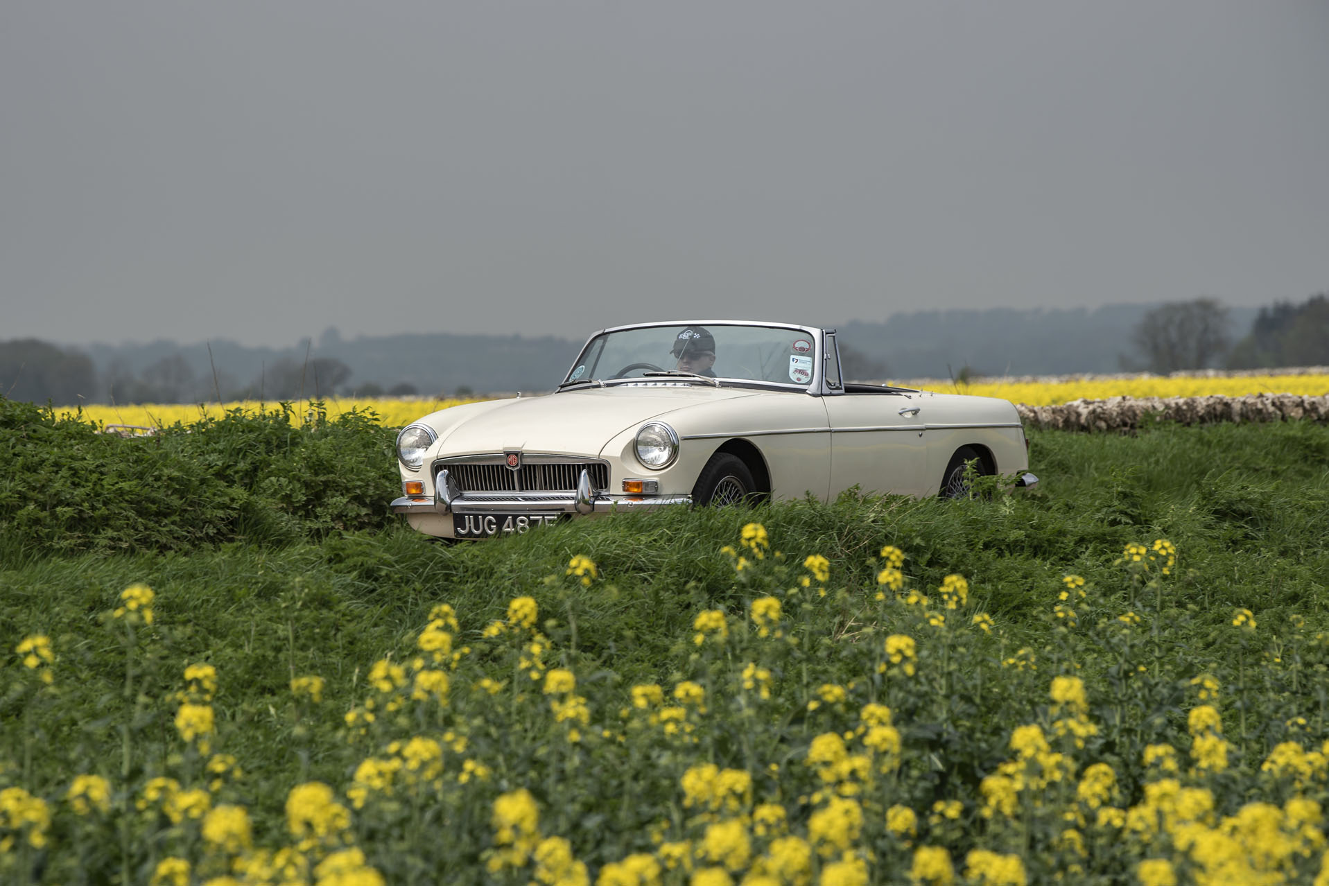 David Bond, MD of Footman James in his MGB