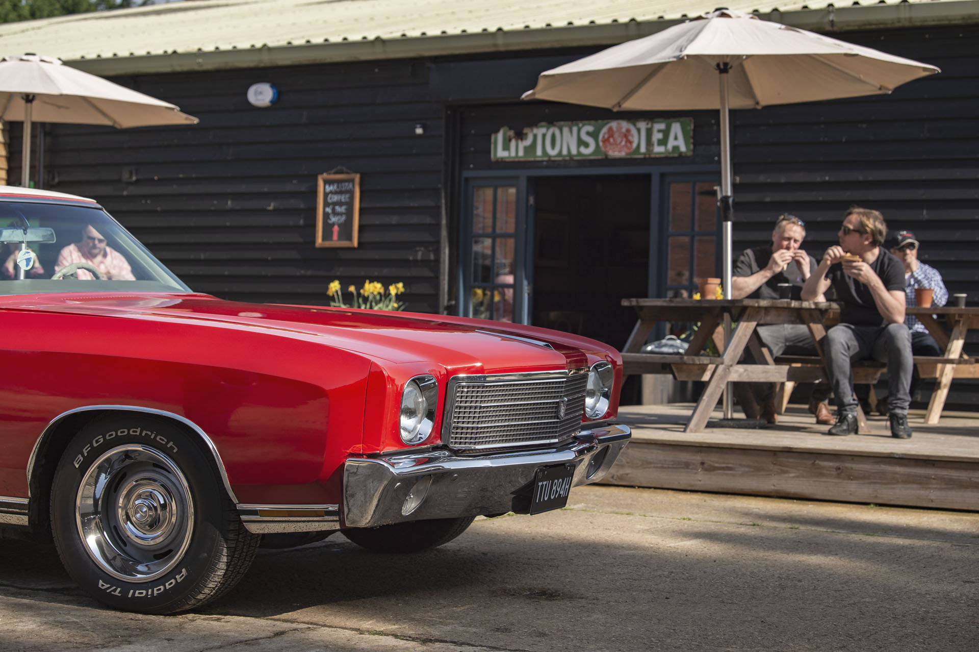 Red Chevrolet in front of Classic Motor Hub cafe