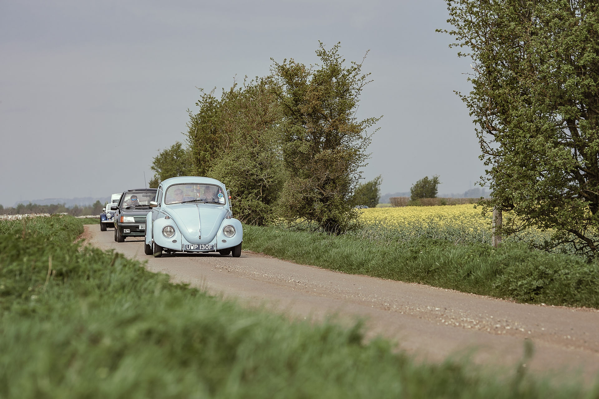 Classic convoy led by blue Volkswagen