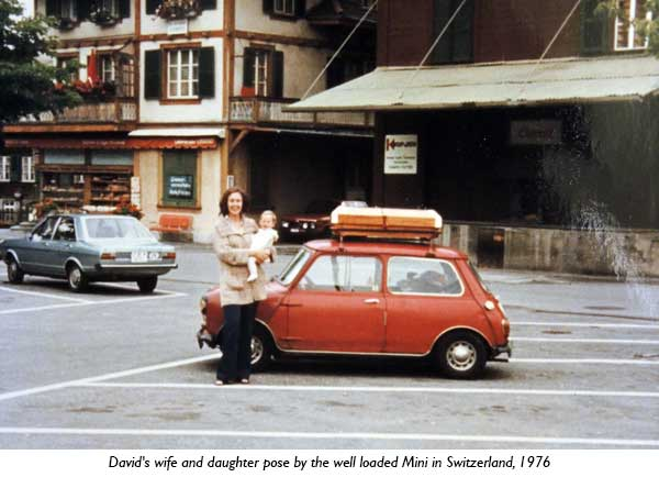 David's wife and duaghter pose by the well loaded Mini in Switzerland