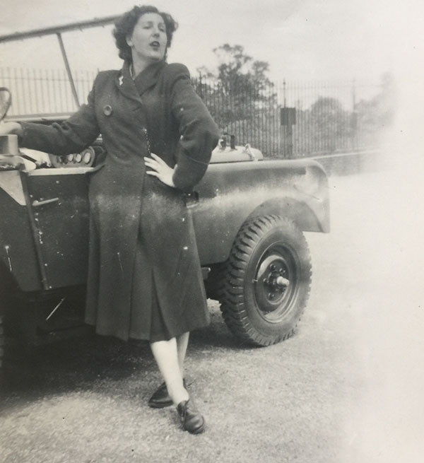 Dorothy posing next to car