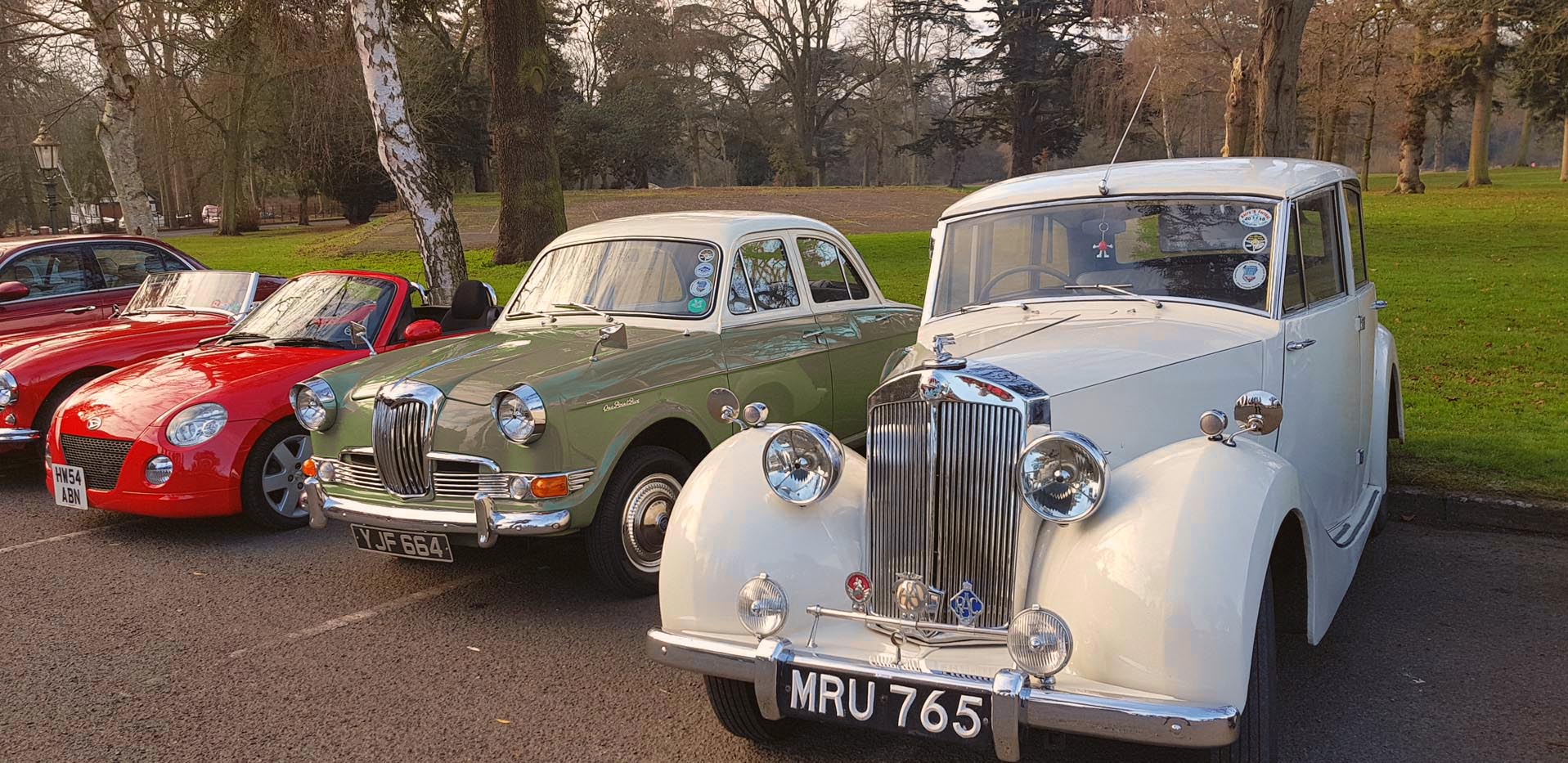 1960 Green Riley and 1953 Triumph.jpg