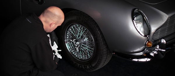 CMC cleaning the wheels of an Aston Martin DB5